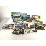 An assortment of 1930s-1990s postcards, most unused (approximately 200)