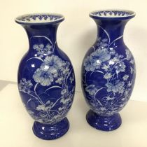 A pair of large Japanese blue and white porcelain vases, possibly Seto, c.1900, of baluster form,