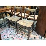 A pair of Scottish elm country dining chairs c.1800, with arched spar backs and shaped saddle