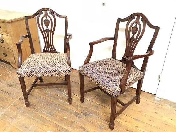 A pair of Sheraton style urn and pierced splat back open arm side chairs with stuffover seats, on