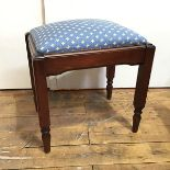A stained pine stool with upholstered slip in top on square fluted supports (45cm x 45cm x 35cm)
