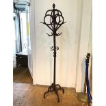 An Art Nouveau style hallstand, with acorn finial above a knotted eight peg coat hanger (h.185cm)