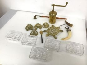 A collection of brassware including a trivet in the form of a turtle, horse brasses and a grinder