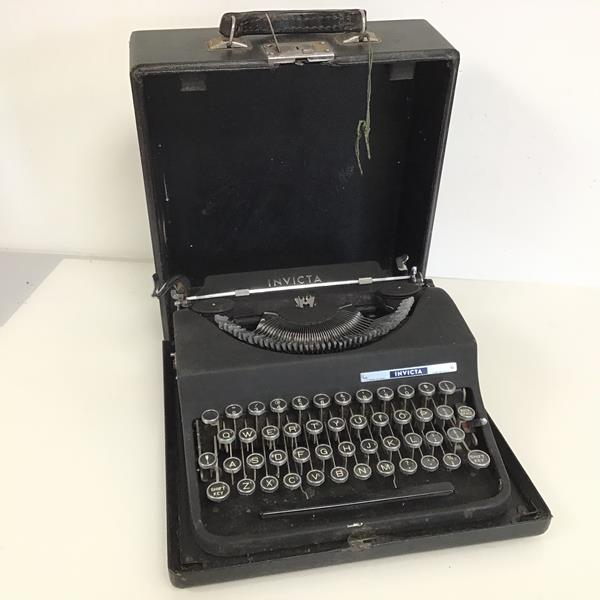 An Invicta Italian typewriter, with travelling case bearing label W. Simpson Bell & Co.,
