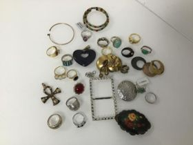 An assortment of costume and silver jewellery including a silver Egyptian style ankh, rings, buckle,