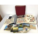 Stamp interest: a collection of stamps including two albums with British and Worldwide stamps, an