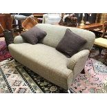 A stylish modern John Lewis two seater sofa upholstered in Harris Tweed style fabric, with leather