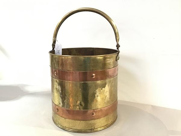 A brass copper banded coal bucket with swing handle to top (29cm x 29cm)