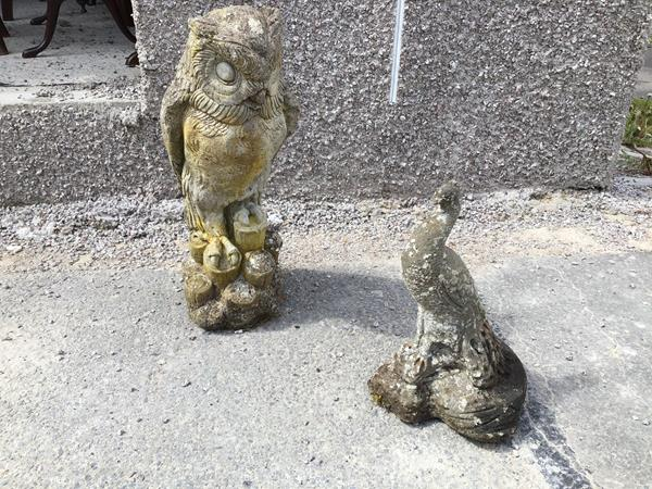 A composition garden ornament in the form of an Owl (h.43cm) and another in the form of a Peacock (