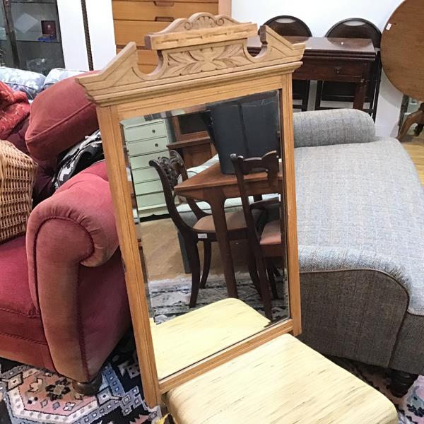 A wall mirror with moulded surmount over bevelled glass, formerly a dressing table mirror (83cm x