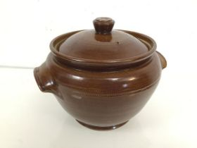 A Pearsons of Chesterfield lidded pot, the body with handles to sides, with allover chocolate