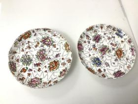 An unusual pair of 19thc dishes, each with a polychrome pixellated floral design, with other
