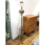 An Edwardian telescopic brass oil lamp converted to floor lamp, with fluted centre column, raised on