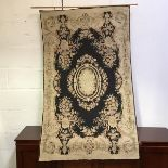 A hook stitch gabbeh-style Kashmir wall hanging with central foliate cartouche and four vases with