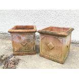 A pair of terracotta garden planters, with lozenge decoration (37cm x 36cm x 36cm)