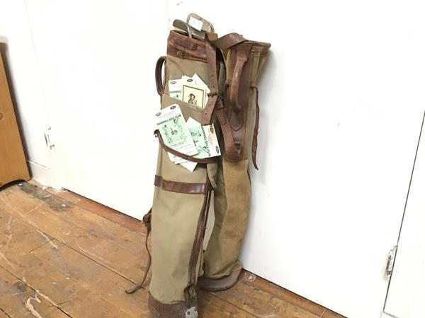 Two vintage canvas leather mounted golf club bags and two hickory shafted clubs etc. (tallest bag: