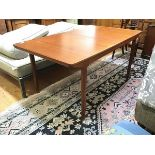 An A.H. Mackintosh & Co. Ltd. teak dining table with two intergral folding leaves (fully extended: