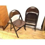 A pair of 1970s folding chairs, the domed top rail over an imitation lizardskin back splat with