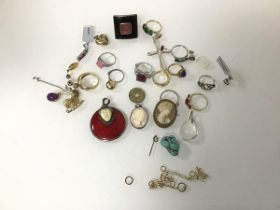 An assortment of costume and silver jewellery including rings, pendant, cameos, chain fragments etc.