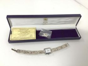 """A Brooks & Bentley lady's wristwatch, with certificate of authenticity as a """"Footprints"""" watch,"""