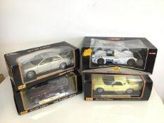 Maisto diecast model cars including a Thunderbird show car, BMW, Jaguar and Jeep, all in original
