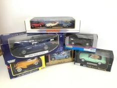 Diecast model cars, including Motor Max, Ford and BMW, a Superior Ford Mustang, red box BMW and a