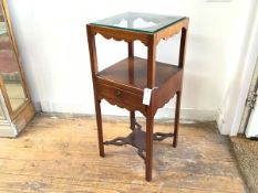 A George III mahogany washstand, the square top with basin aperture, tooth spill aperture and