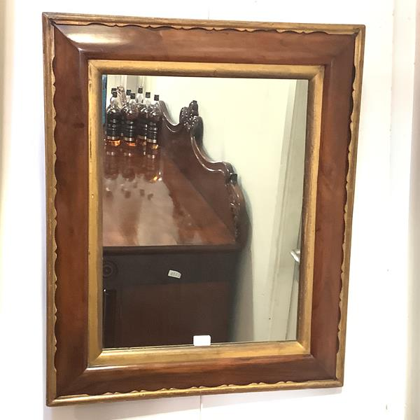 A 19th century rosewood wall mirror, the rectangular plate within a cushion-moulded frame with