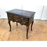 A George II style painted lowboy, the rectangular top above four variously sized drawers, raised
