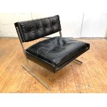 Britian: A 1960's leather armchair, the buttoned back and fitted cushion seat raised on a chrome-