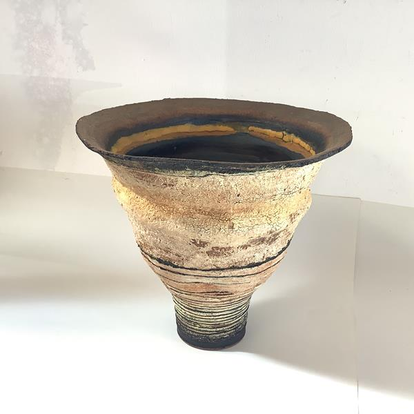 """Robin Welch (1936-2019), a stoneware vase, of tapering circular form, textured with """"volcanic"""""""