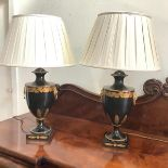 A pair of modern toleware urn-form table lamps, each with gilt acorn and oak leaf decoration, and
