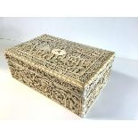 A fine Chinese Export carved ivory work box, Canton, c. 1800, the rectangular box and lift-off cover