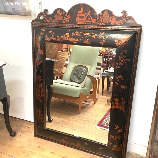 A large Chinoiserie decorated cushion-framed wall mirror in early 20th century style, the