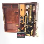 A French late 19th century lacquered brass monocular microscope by Nachet et Fils, Paris, in its