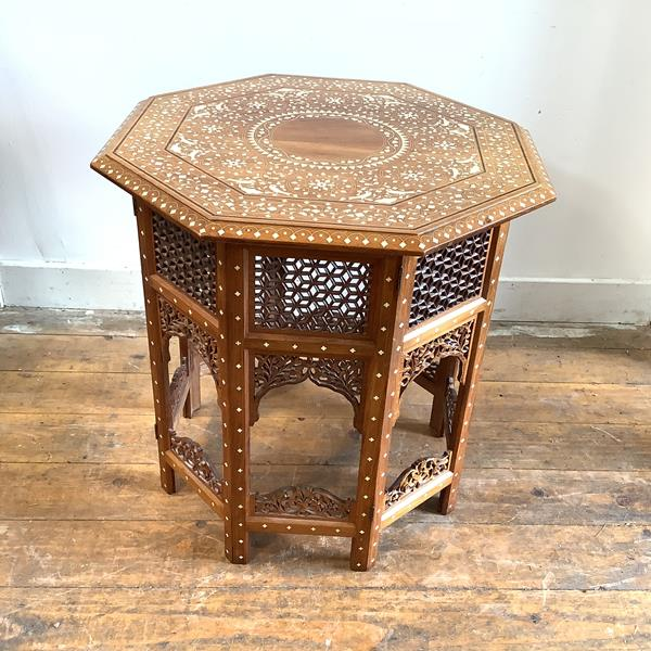 A hexagonal Indian ivory-inlaid rosewood occasional table by Woods, Bird & Co., Jullundur City (