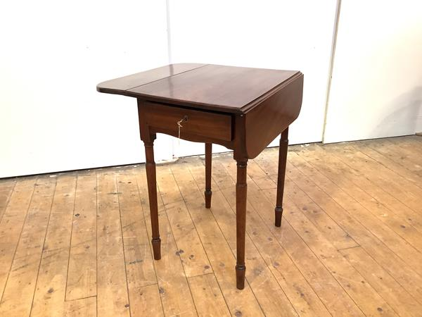A 19th century Pembroke table, of characteristic form, the hinged rectangular top above a frieze