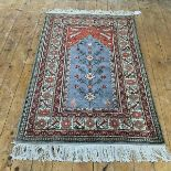 A North-West Persian prayer rug, the grey/blue field with red spandrels within multiple ivory and
