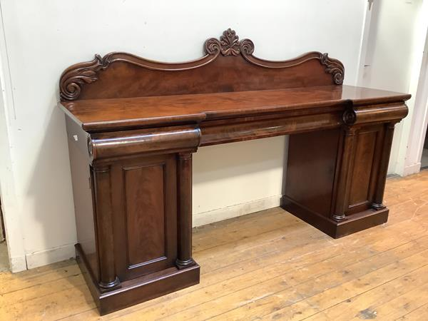 A 19th century mahogany sideboard, c. 1830, the gallery back (possibly associated), incorporating