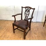 A Scottish George III mahogany elbow chair, the moulded yoke shaped cresting rail with foliate