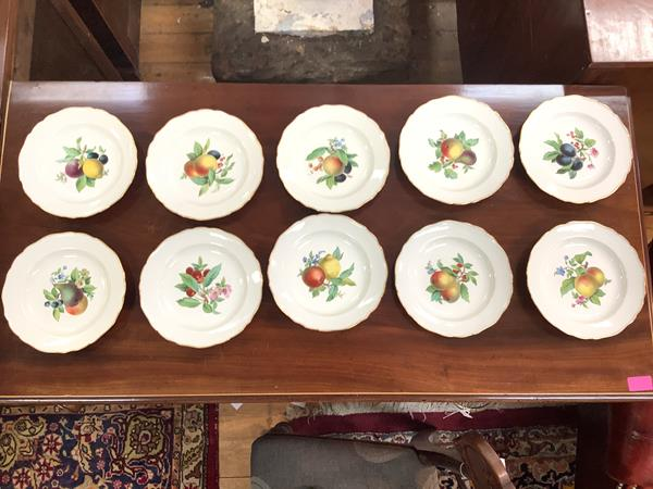 A set of ten Meissen fruit-painted dessert plates, 20th century, each decorated to the well with