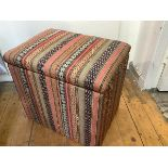 A kilim-covered box ottoman, of cube form. 51cm by 53cm by 39cm