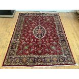 A North-West Persian hand-woven wool carpet, the raspberry sorbet-coloured field enclosing a