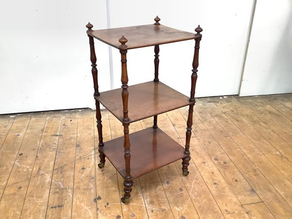 A mid-19th century mahogany Whatnot of small proportions, the three rectangular tiers surmounted