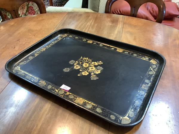 A late 19th century black japanned toleware galleried tray, rectangular, centred by a lacquered gilt