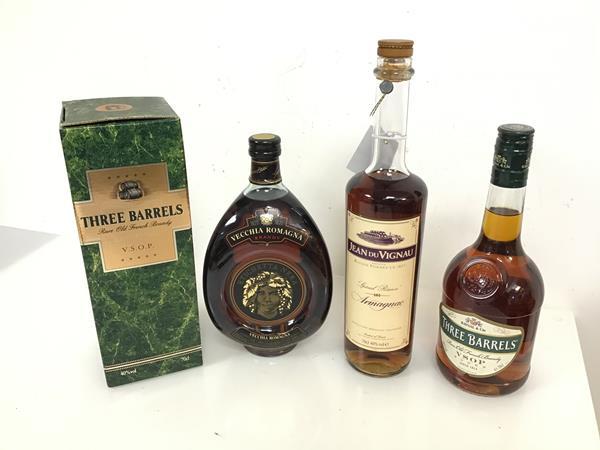 A bottle of Jean du Vignau armagnac, two bottles of Three Barrels brandy, one in original box and