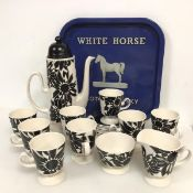 A Carltonware coffee service including a coffee pot (30cm x 22cm x 11cm), eight coffee cups and