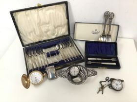 A mixed lot including three pocket watches, one Waltham with gilt metal case, an Edwardian silver