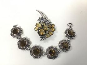 A silver citrine set spray brooch, and a silver Cairngorm set bracelet (17cm)