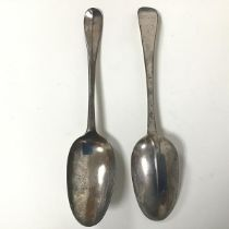 A pair of silver Georgian spoons, each initialled M.D. to handle and MB EB AMH verso (20cm) (95.